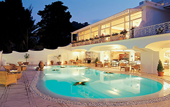 Europe Italy Naples Amalfi Coast Capri Hotel la Residenza outdoor pool lounge nighttime - luxury vacation destinations