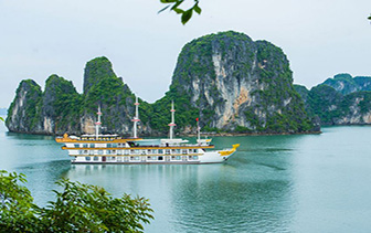 Asia Vietnam Dragon Legend Cruise ship on Halong Bay with karst formations  - luxury vacation destinations