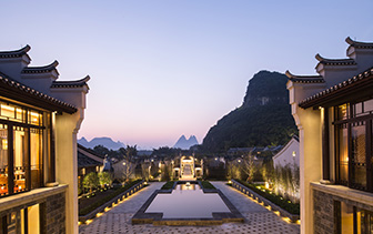 Asia China Guilin Banyan Tree Yangshuo hotel view of karst mountains from lobby at night - luxury vacation destinations