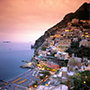 Europe Italy Amalfi Coast Positano beautiful romantic cliffside at dusk sunset - luxury vacation destinations