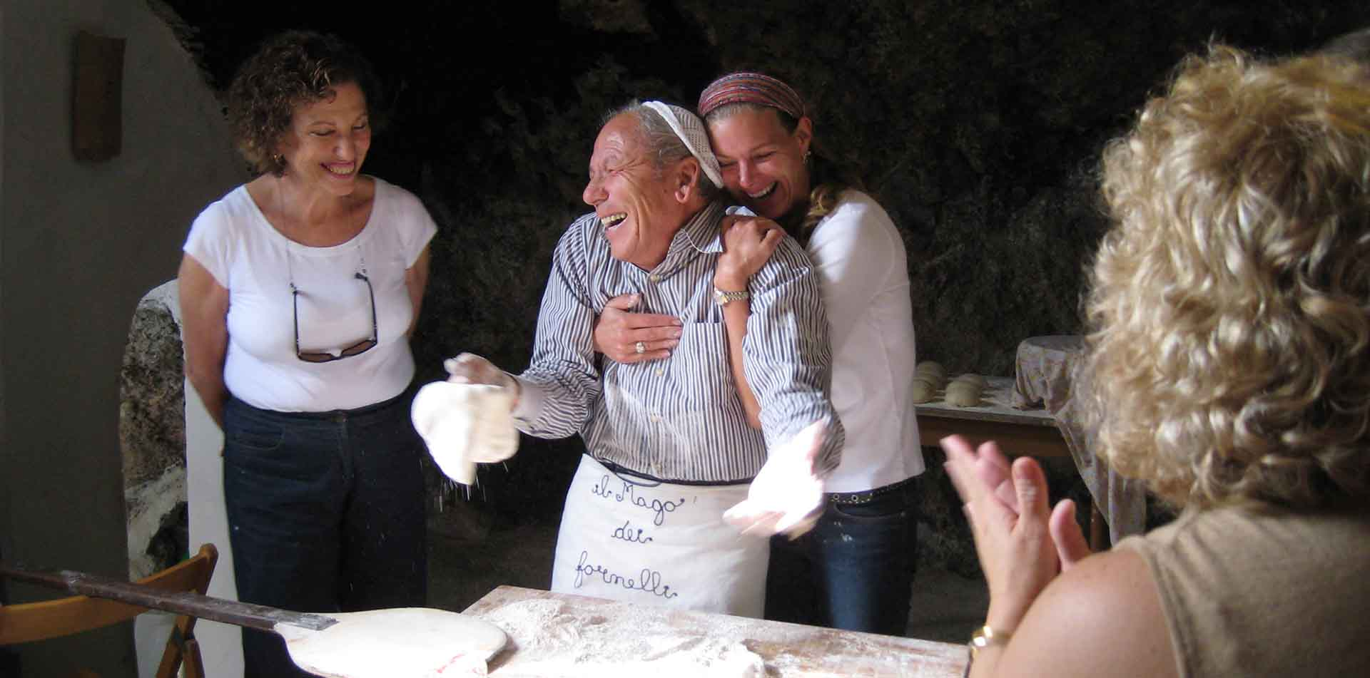 Friends Making Pizza in Italy