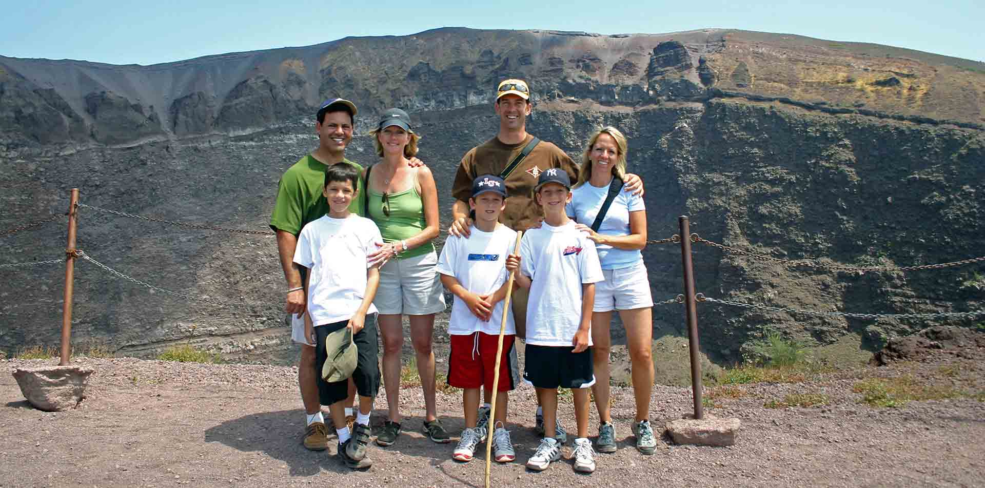 Europe Italy Amalfi Coast Naples family smiling in front of Mt Vesuvius - luxury vacation destinations