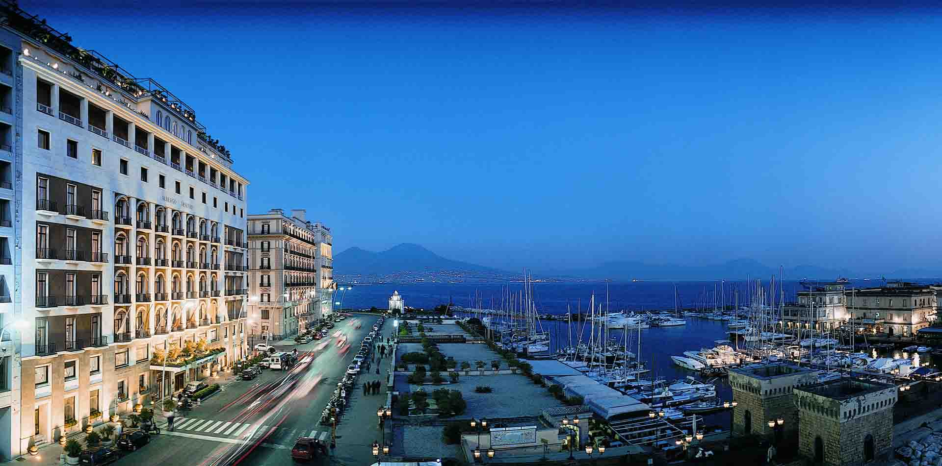 Europe Italy Amalfi Coast Naples Grand Hotel Vesuvio sailboats by the bay at night - luxury vacation destinations