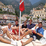 Europe Italy Amalfi Coast Positano kids smiling on a boat Tyrrhenian sea - luxury vacation destinations