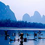 Asia China Yangshuo Guilin cormorant fisherman on the Li River at daybreak - luxury vacation destinations