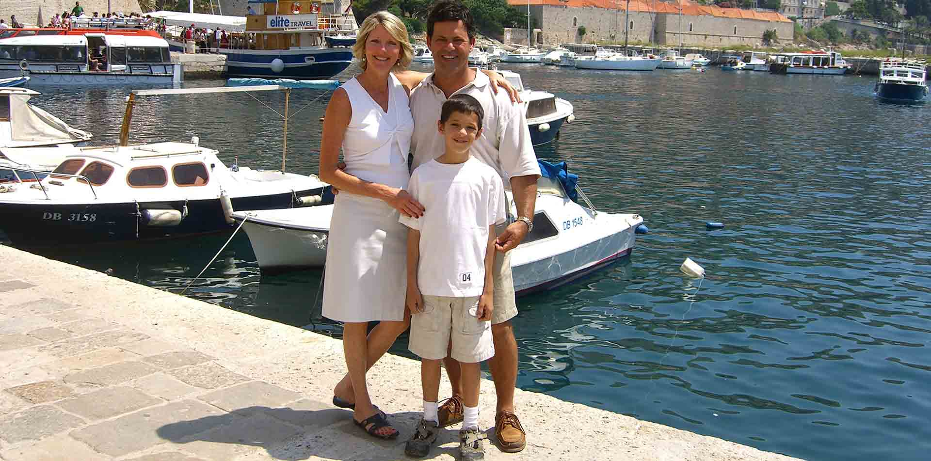 Europe Croatia happy family smiling concrete dock tourists boat excursion port - luxury vacation destinations