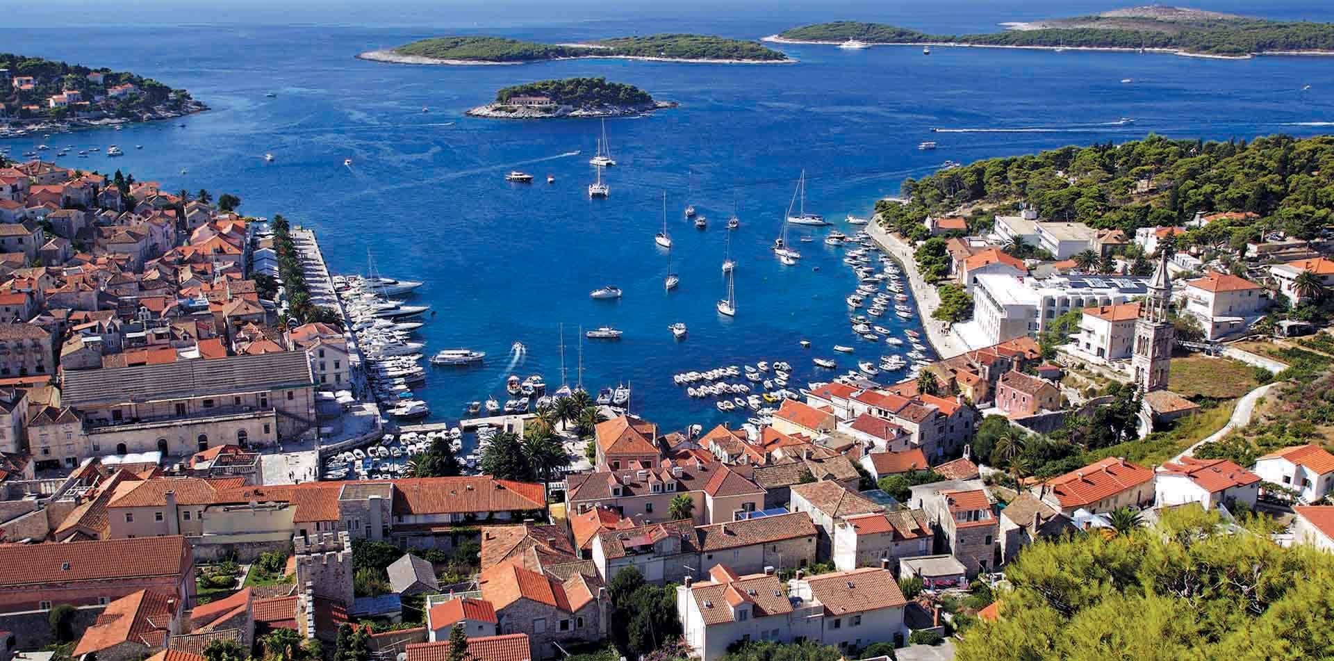 Europe Croatia Hvar blue Dalmatian Coast beautiful view red tile roofs boats port - luxury vacation destinations