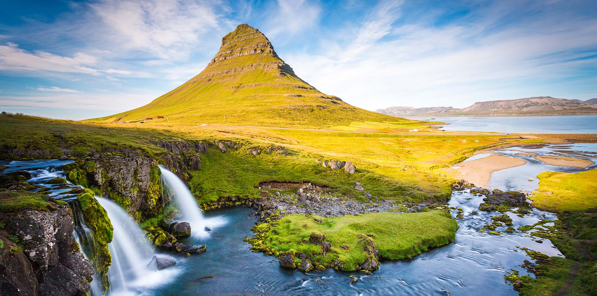 Europe Iceland Snaefellsnesnes Peninsula waterfall with Kirkjufell Mountain in background - luxury vacation destinations