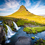 Europe Iceland Snaefellsnesnes waterfall with Kirkjufell Mountain at sunrise - luxury vacation destinations