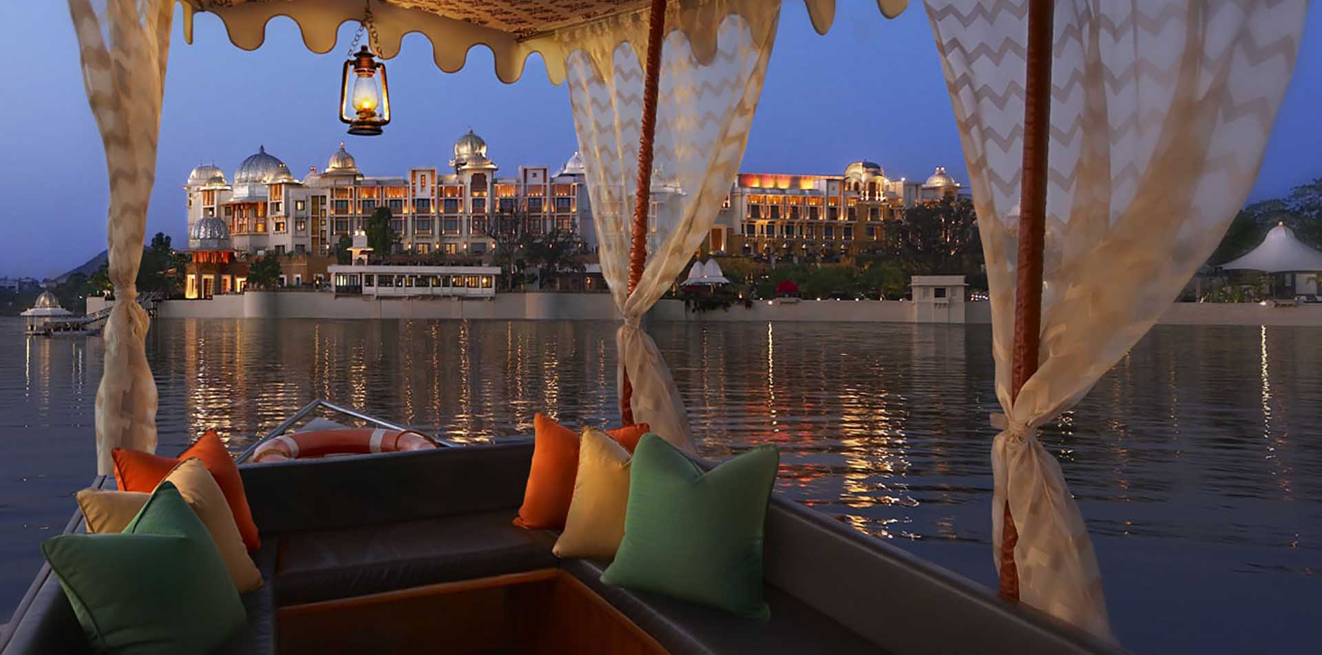 Asia India Rajasthan Udaipur view of Club Mahindra Resort Hotel from boat on the water - luxury vacation destinations