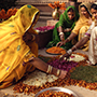Asia India local women in traditional clothing making art with flower petals - luxury vacation destinations