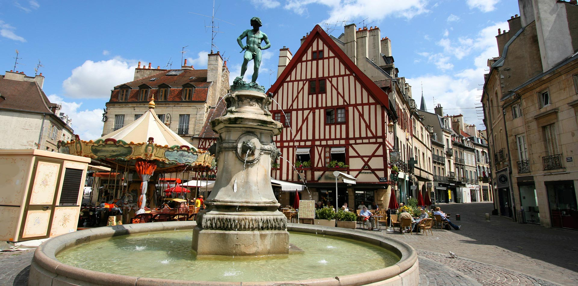 Europe France Dijon Francois-Rude square with fountain and traditional buildings - luxury vacation destinations