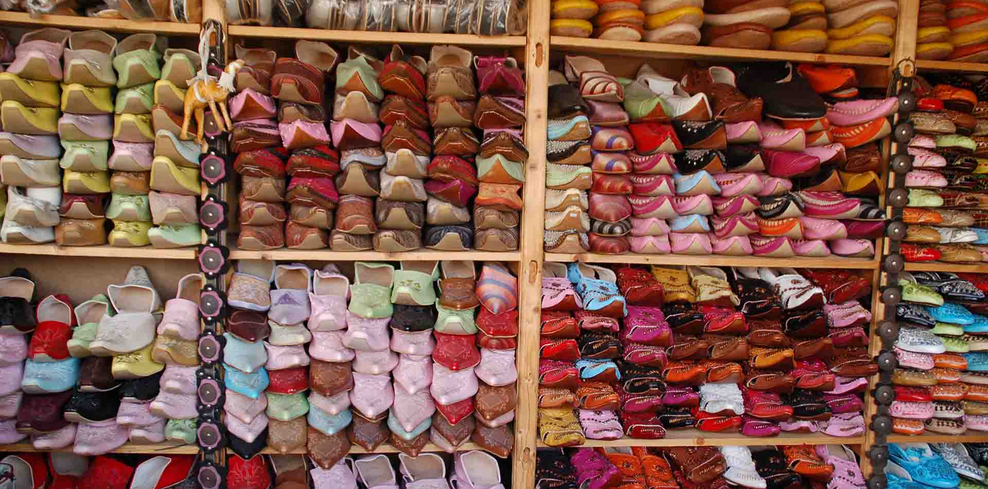 Africa Morocco traditional colorful handmade Moroccan shoes for sale in souk - luxury vacation destinations