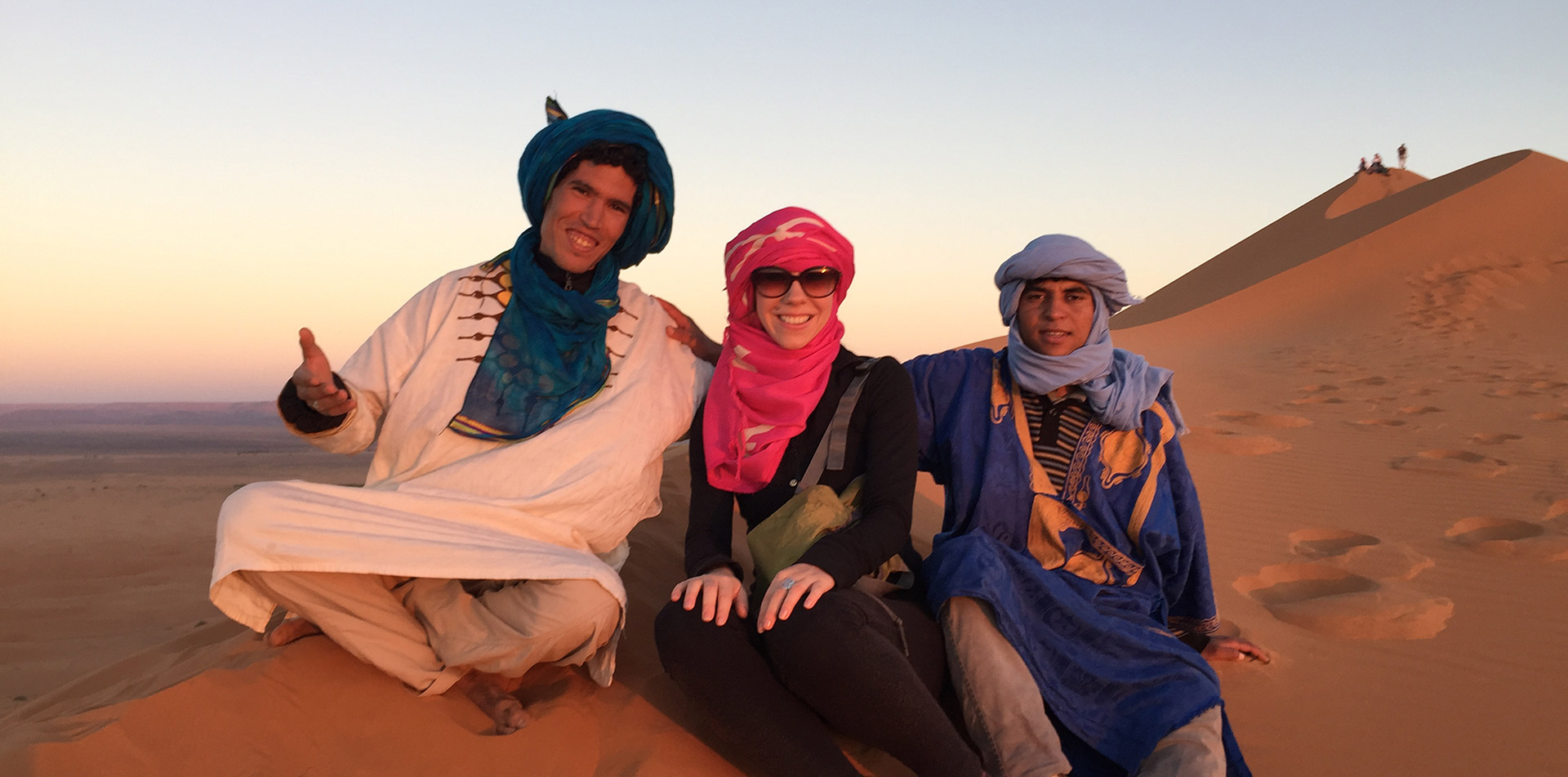 Group of Travelers in Sand Dunes of Morocco