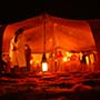 Africa Morocco Sahara Desert Berber encampment culture nomadic colorful tribal tent at night - luxury vacation destinations
