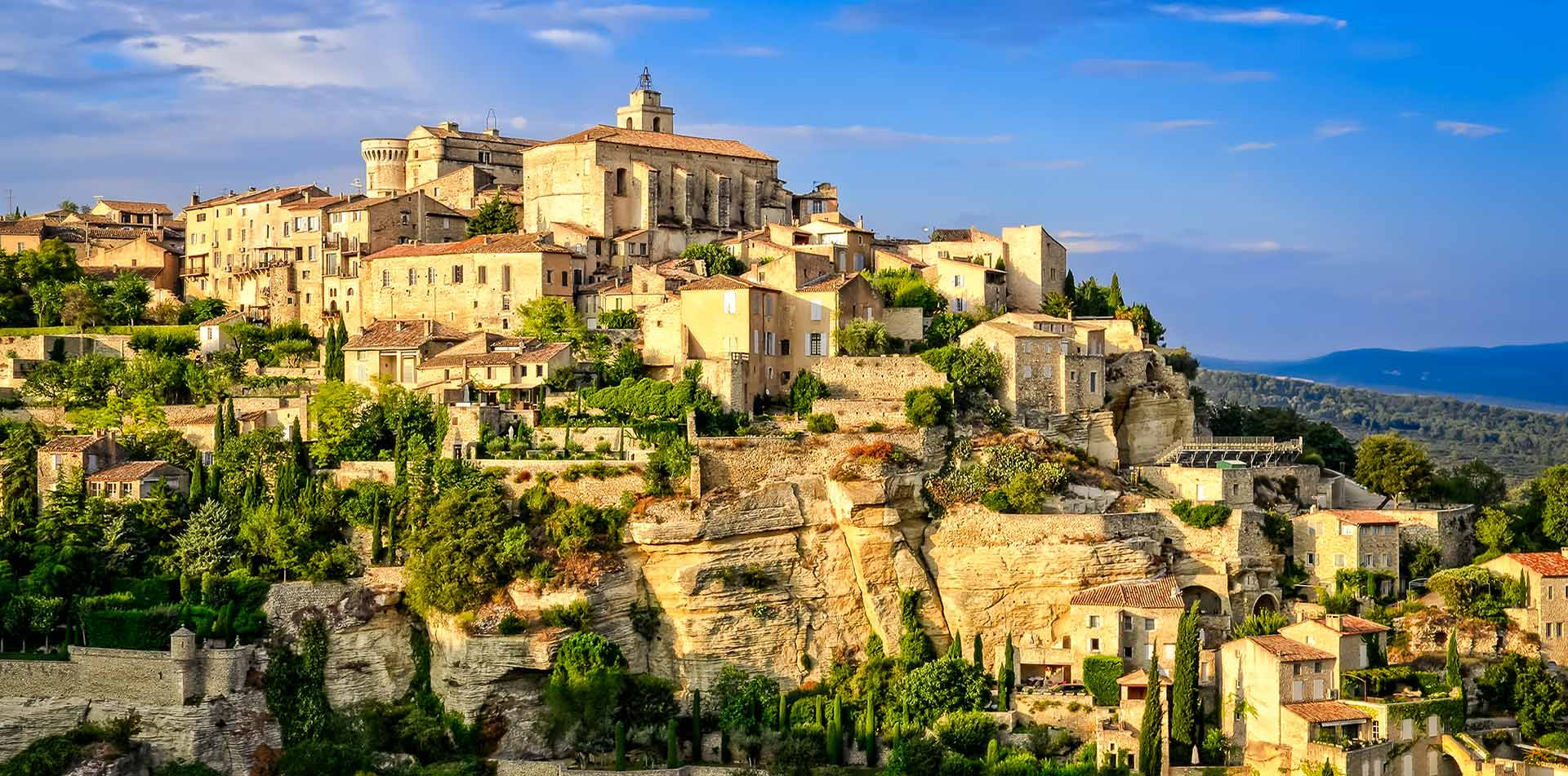 Europe France Provence Gordes medieval hilltop village commune at sunset - luxury vacation destinations