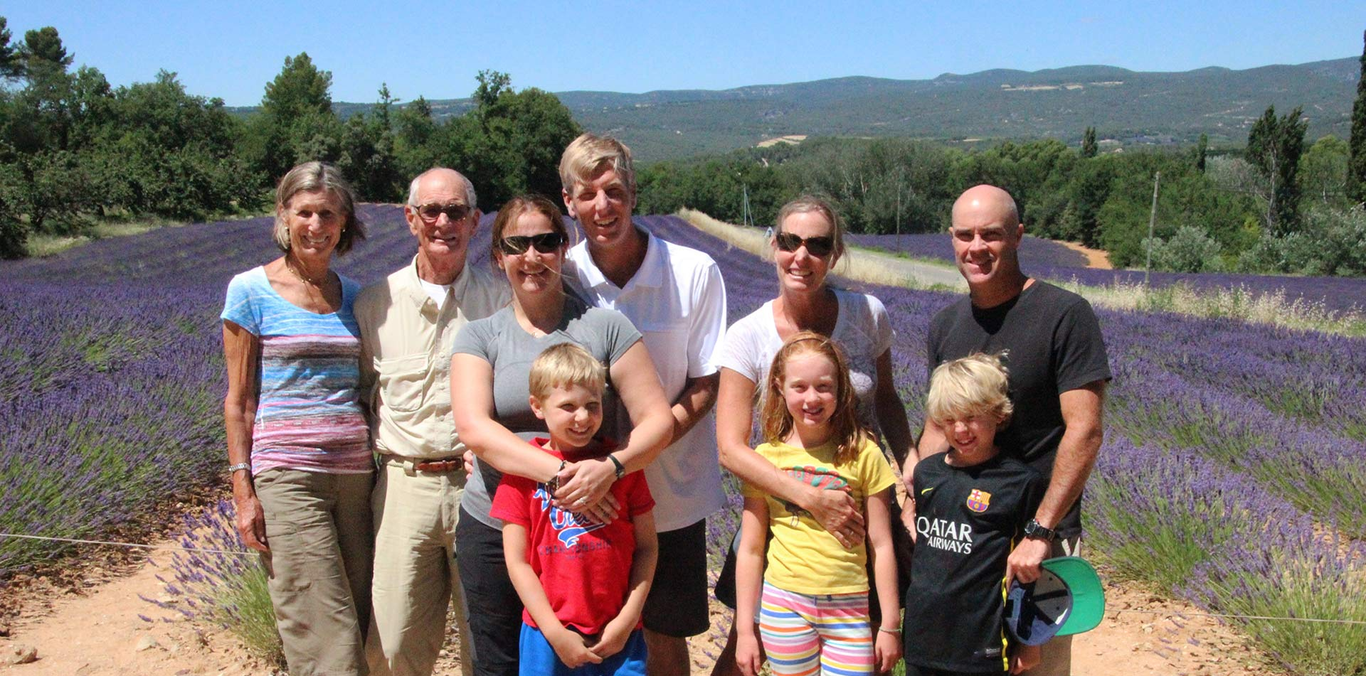 Europe France Provence family smiling in lavender fields in Luberon Regional Nature Park - luxury vacation destinations