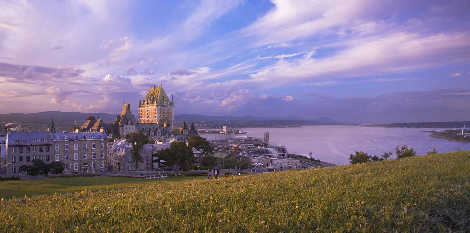 North America Canada Quebec Charlevoix Fairmont Le Chateau Frontenac hotel sunset skyline - luxury vacation destinations