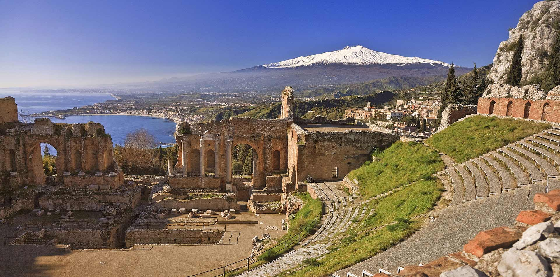 Europe Italy Sicily Teatro Antico di Taormina ancient Greek amphitheater with view of Mt Etna - luxury vacation destinations