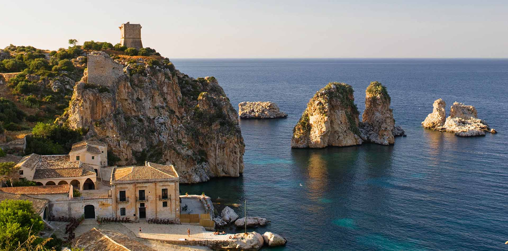 Europe Italy Sicily La Tonnara di Scopello beach with ruins of medieval towers on cliffside - luxury vacation destinations