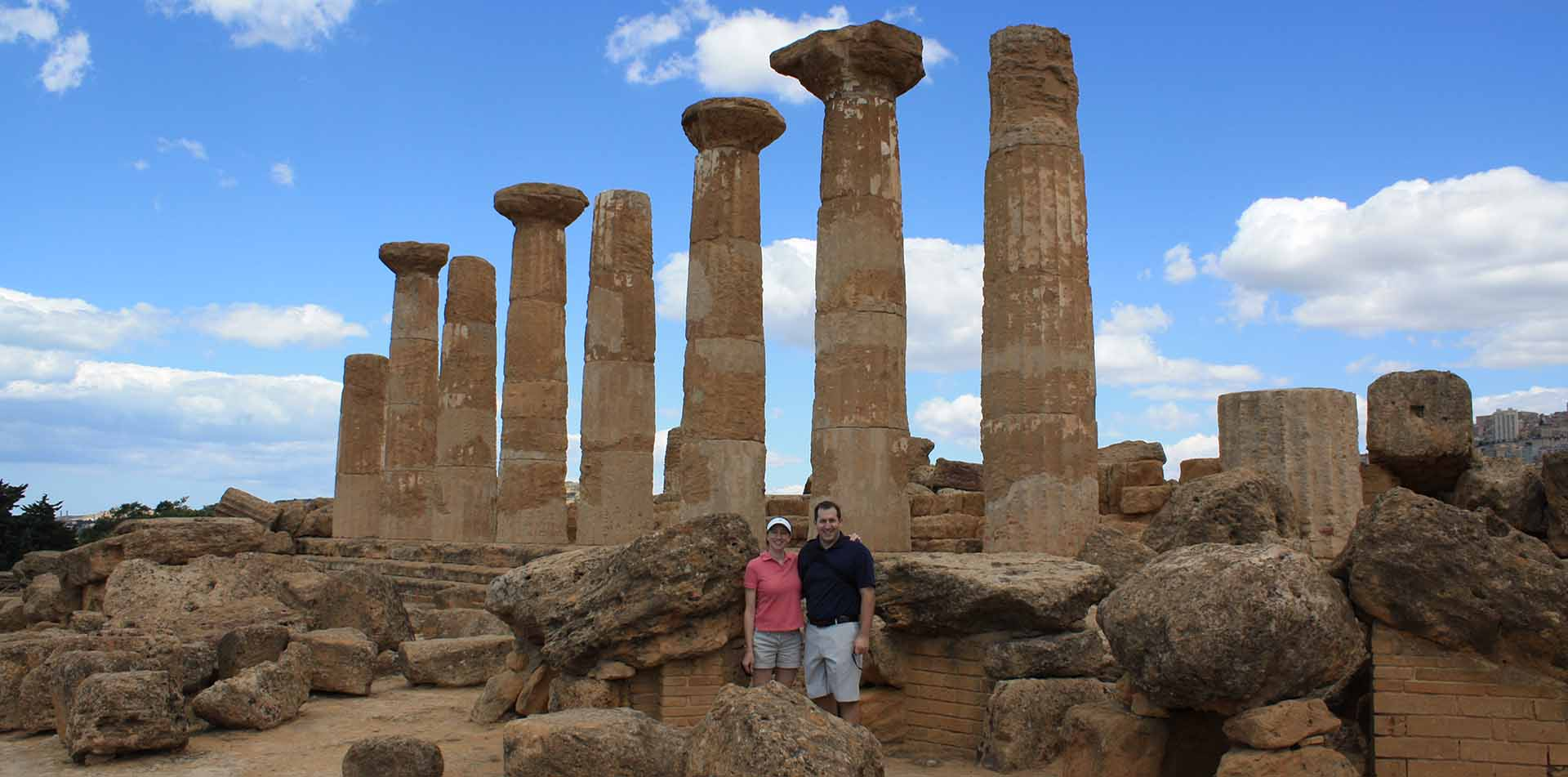 Europe Italy Sicily Agrigento Valley of the Temples couple standing in front of Greek columns - luxury vacation destinations
