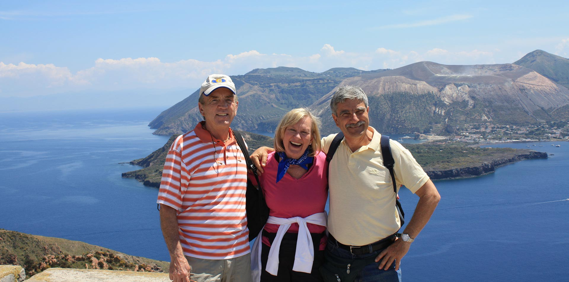 Europe Italy Sicily travelers with local guide on Aeolian Islands overlooking the sea - luxury vacation destinations