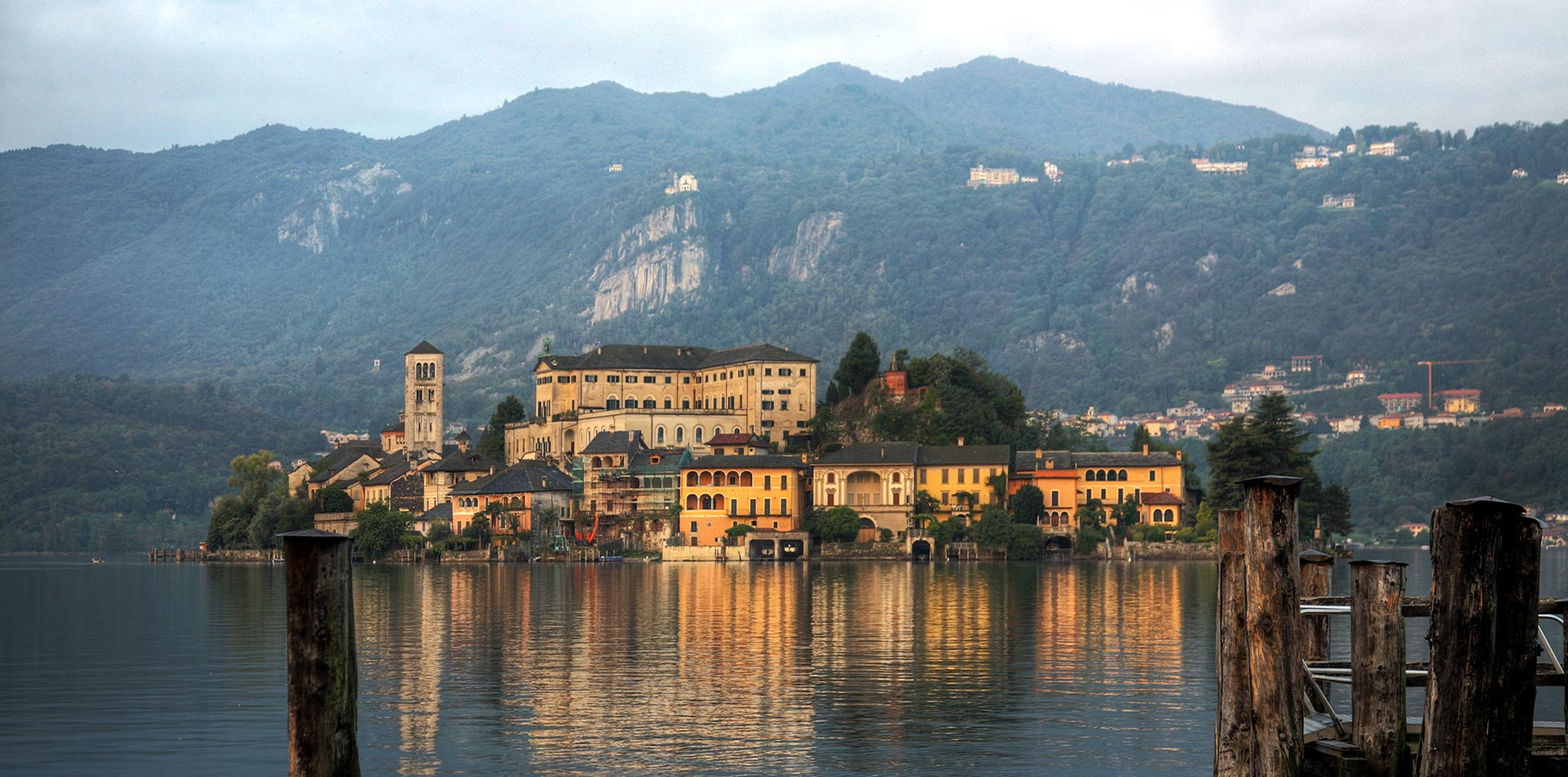 Europe Italy Lake Orta San Giulio Island rugged mountains colorful town scenic water view - luxury vacation destinations