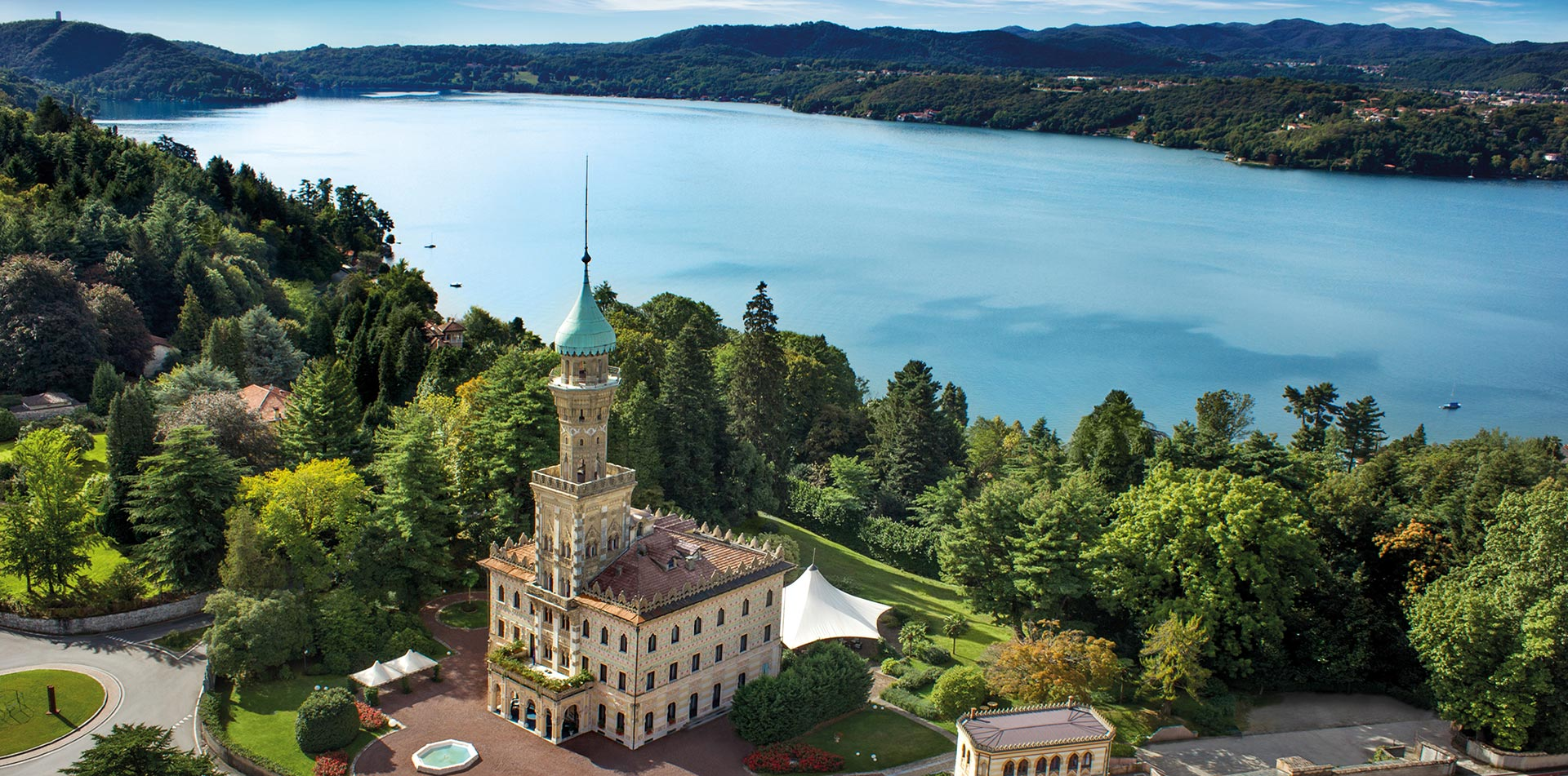 Europe Italy Lake Orta Villa Crespi historic Moorish style architecture scenic aerial view - luxury vacation destinations