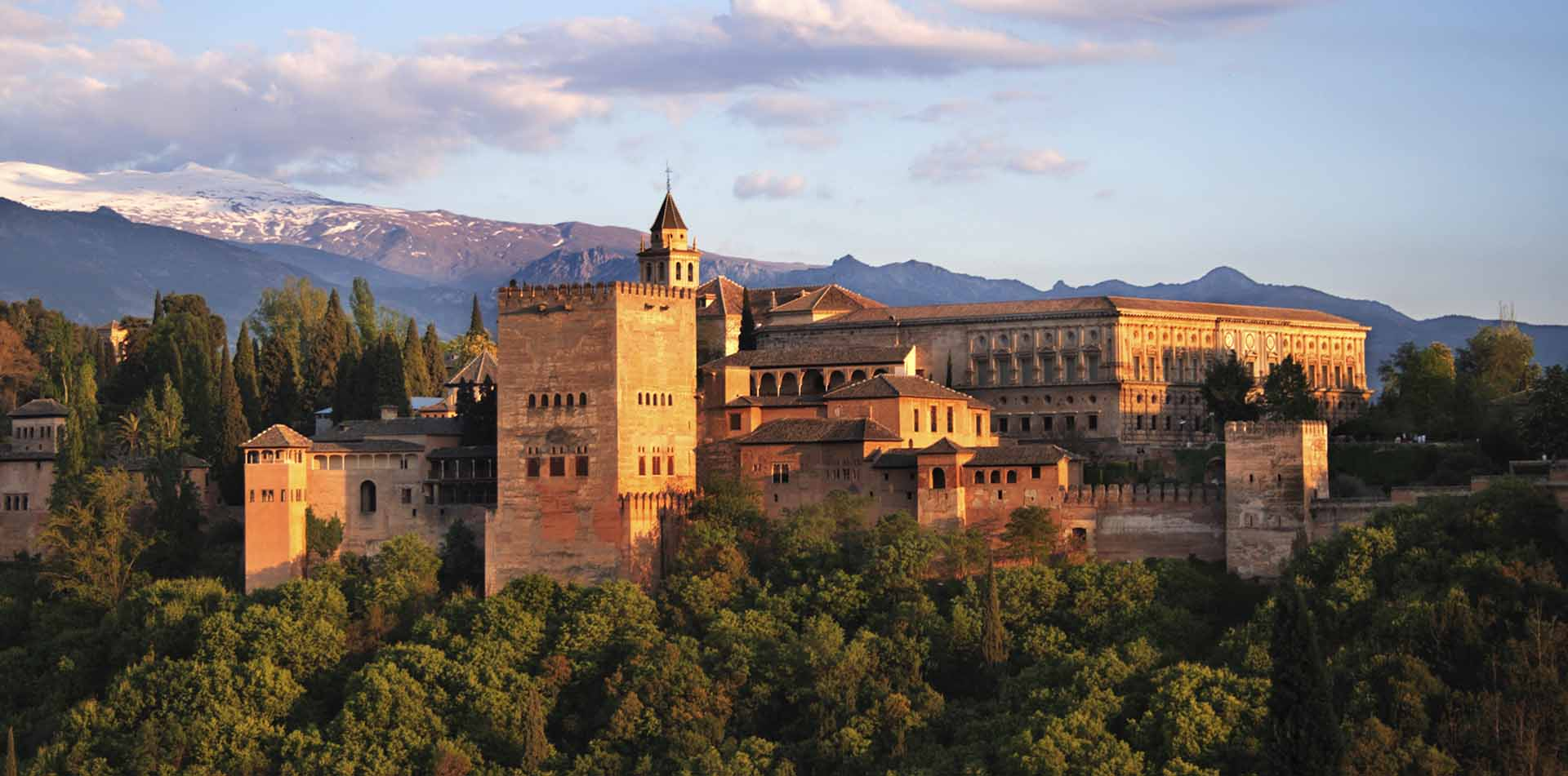 Europe Spain Andalucia Granada The Alhambra exterior view at sunset - luxury vacation destinations