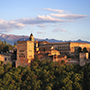 Europe Spain Andalucia city skyline of Granada with mountain background - luxury vacation destinations