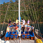 Turkey group of travelers on a sailing gulet boat in Turkish waters - luxury vacation destinations