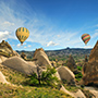 Turkey hot air balloons flying over Goreme National Park and the Rock Sites of Cappadocia - luxury vacation destinations