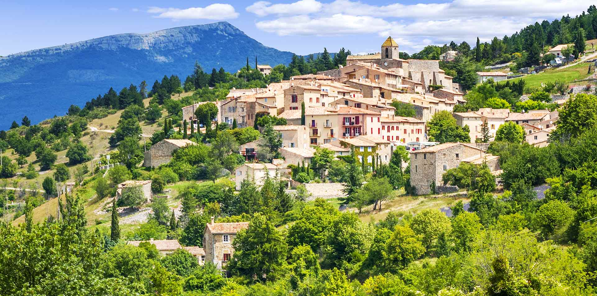 Europe France Provence beautiful hillside town with mountains in background - luxury vacation destinations