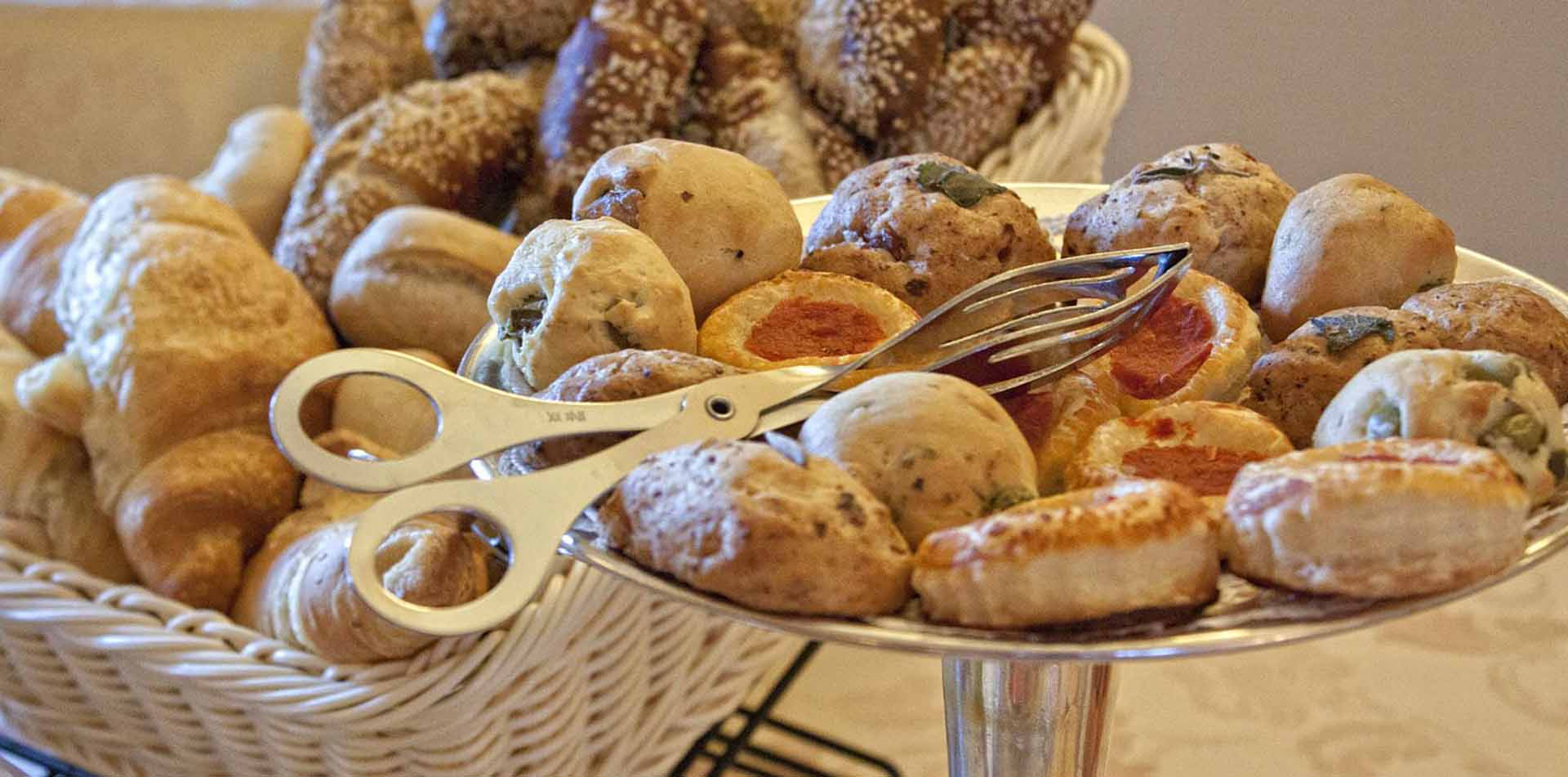 Europe Italy Tuscany freshly baked bread and pastries in basket on display - luxury vacation destinations