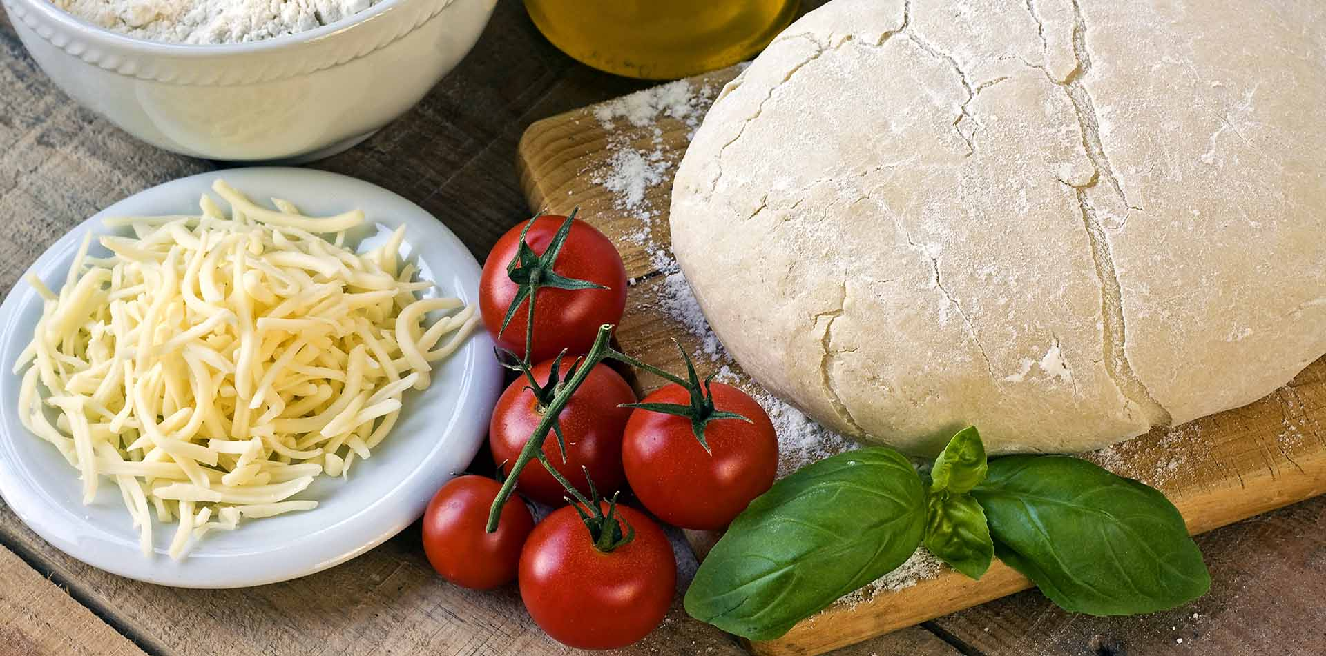 Europe Italy Tuscany pizza ingredients dough tomatoes cheese olive oil food wine - luxury vacation destinations