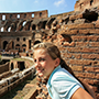 Europe Italy Rome traveling girl exploring the inside of the ancient Colosseum - luxury vacation destinations