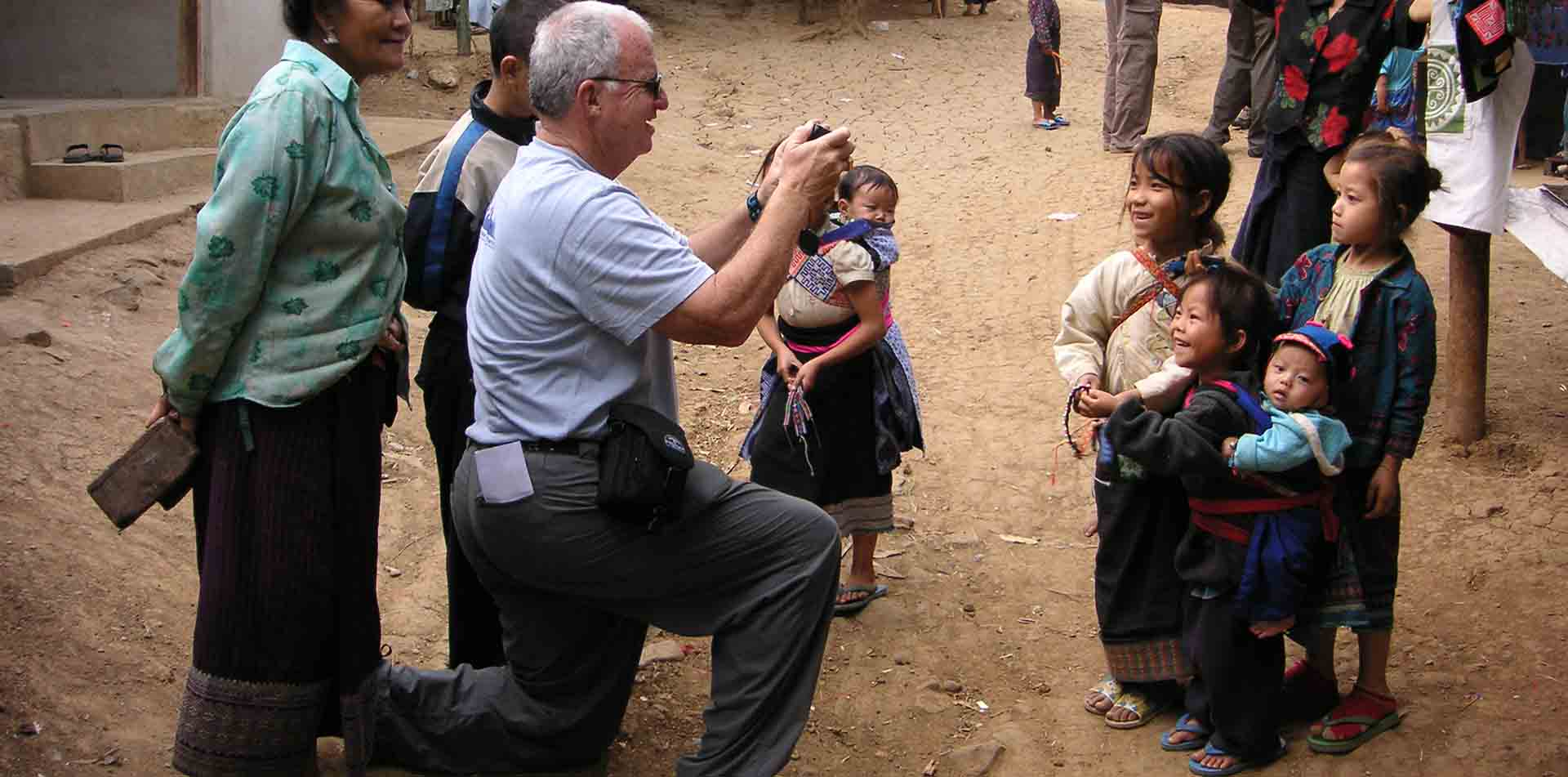 Tourist with Village Children, Vietnam