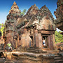 Asia Cambodia Siem Reap travelers posing in ruins of Angkor Wat temple - luxury vacation destinations