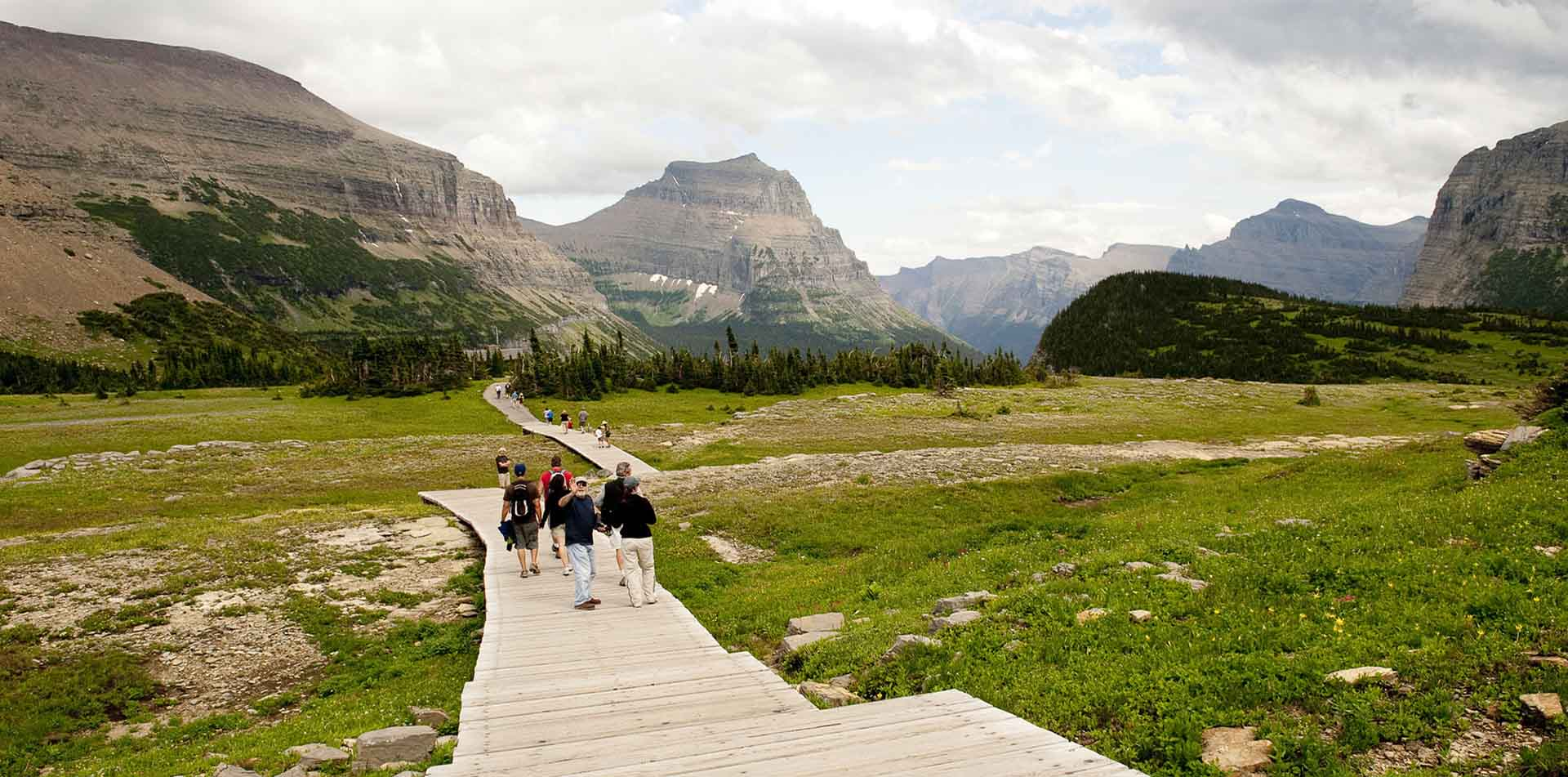 North America United States Montana group hike trail scenic mountains field outdoors nature - luxury vacation destinations