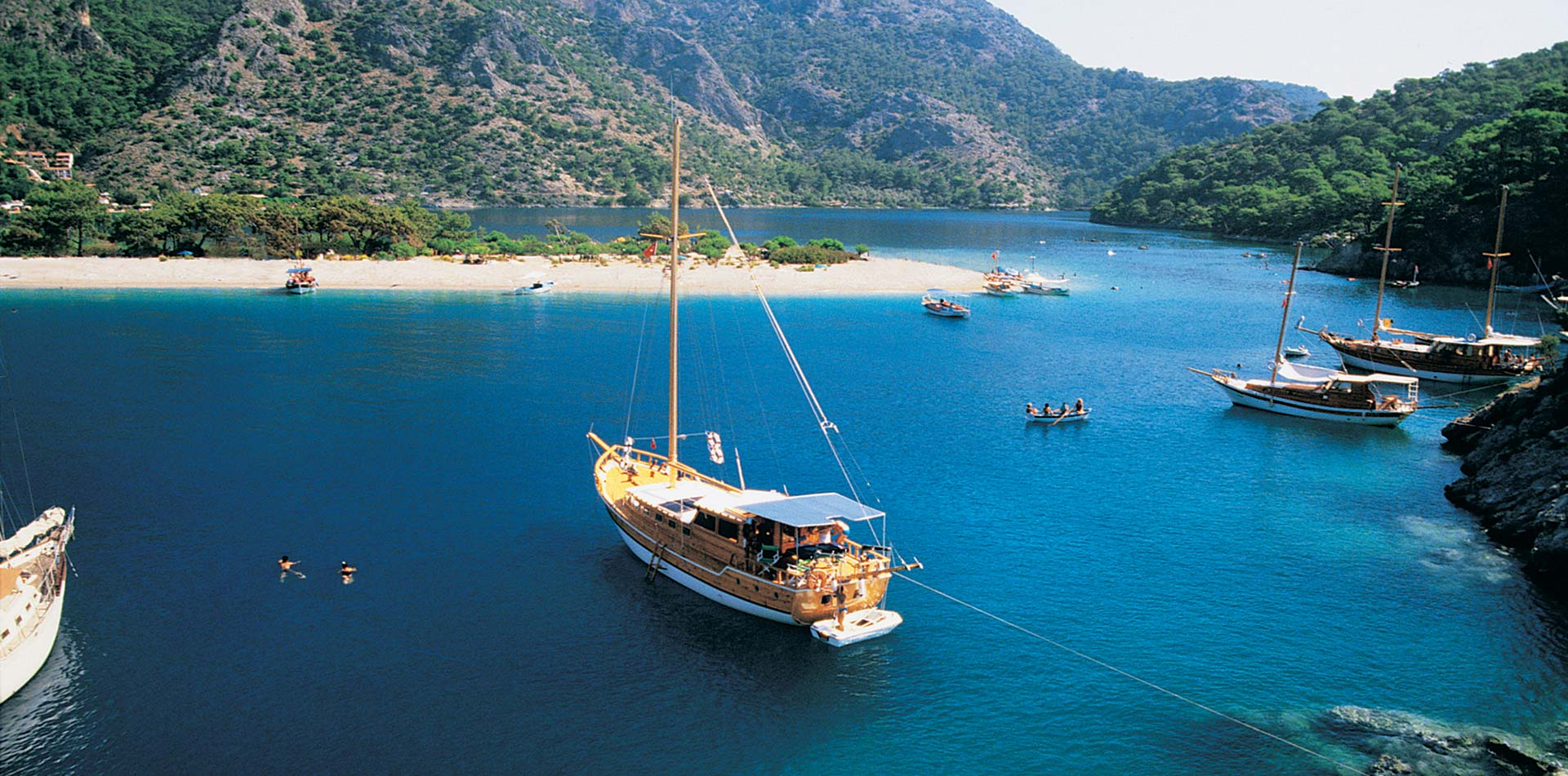 Turkey sailing gulet boat in waters of Turkish harbor - luxury vacation destinations