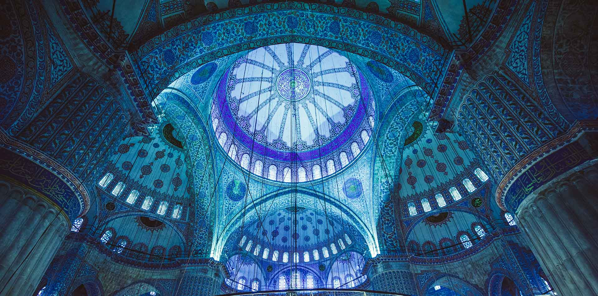 Turkey Istanbul upward interior view of the Blue Mosque dome and atrium - luxury vacation destinations