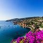 Europe France French Riveria Villafranche-sur-Mer idyllic colorful port town purple flowers - luxury vacation destinations