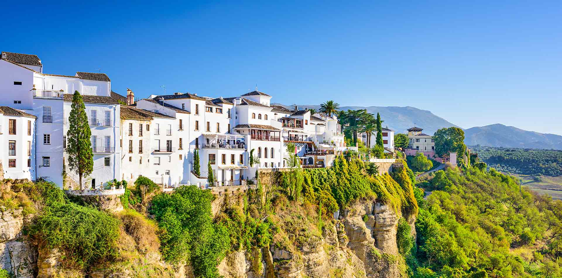 Europe Spain Andalucia Ronda and Setenil white cliffside building - luxury vacation destinations