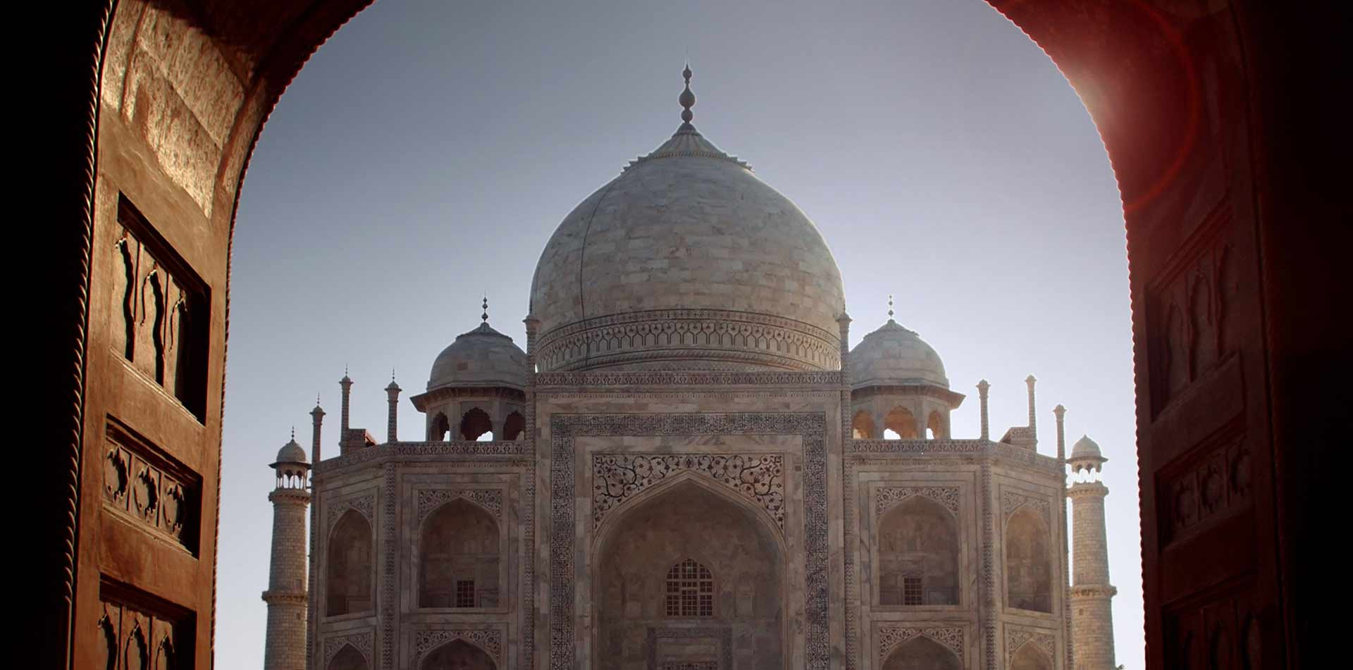 Asia India Agra view of Taj Mahal dome from archway UNESCO world heritage site - luxury vacation destinations
