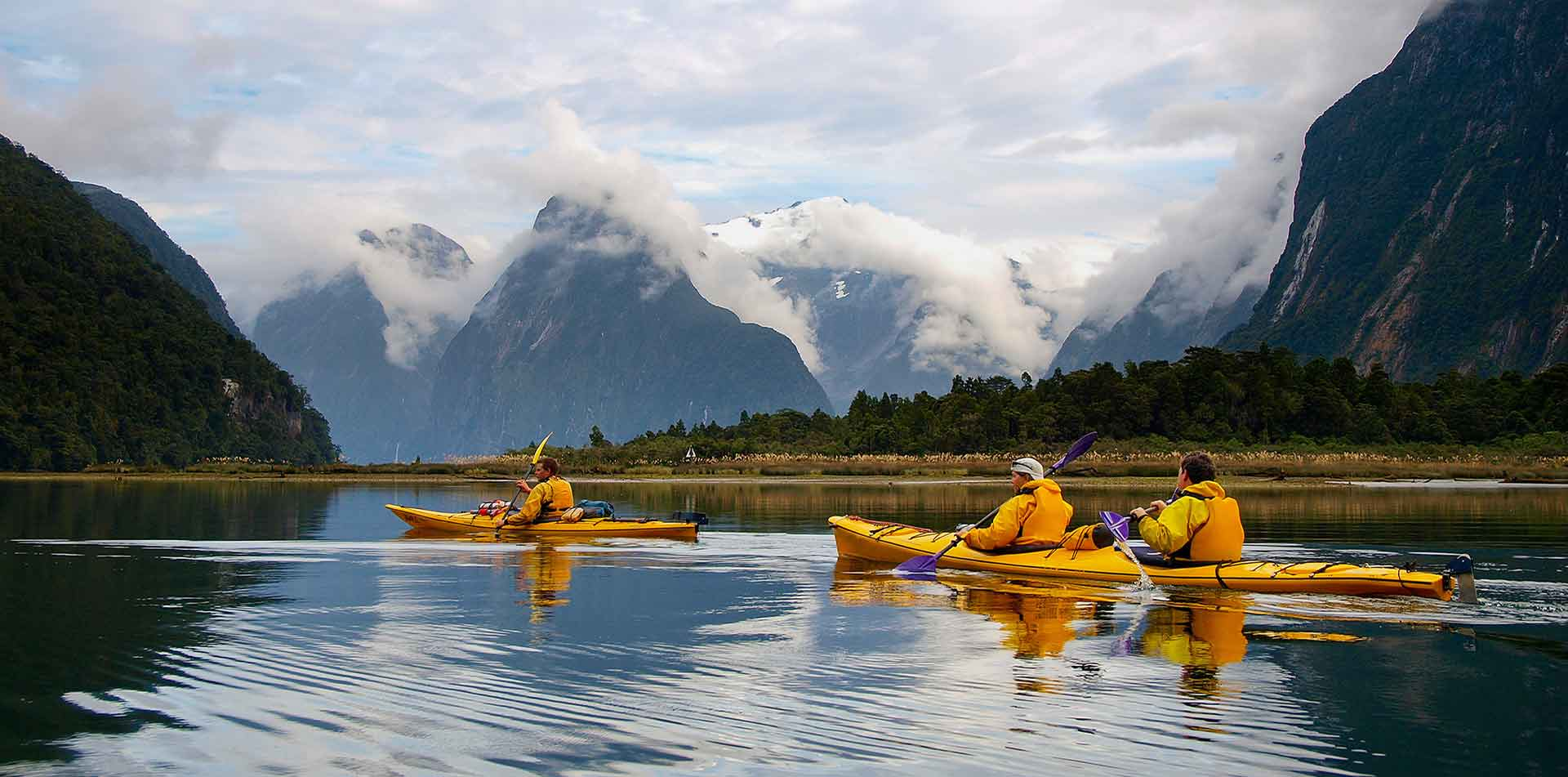 Oceania New Zealand South Island people kayaking in Milford Sound - luxury vacation destinations