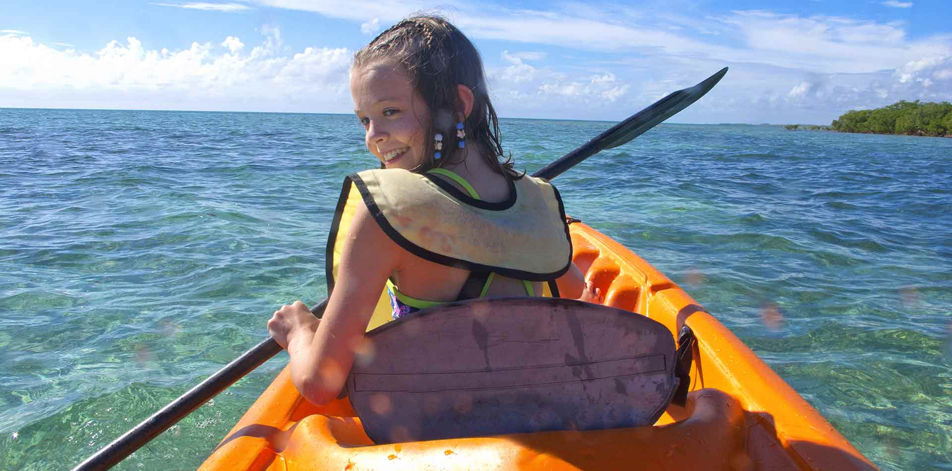 Central America Panama girl kayaking on blue coastal waters - luxury vacation destinations