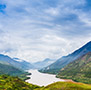 Asia China aerial view of Yangtze River flowing through green mountain valley - luxury vacation destinations
