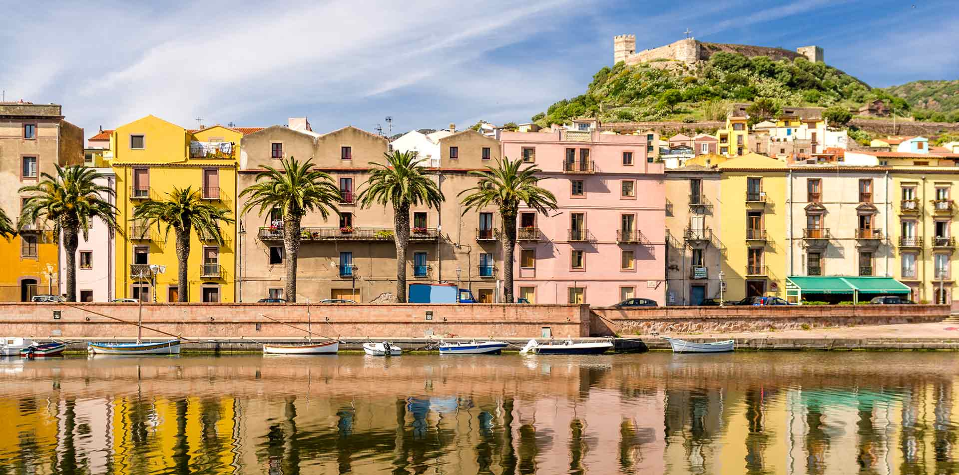 Europe Italy Sardinia colorful seaside buildings in the town of Bosa - luxury vacation destinations