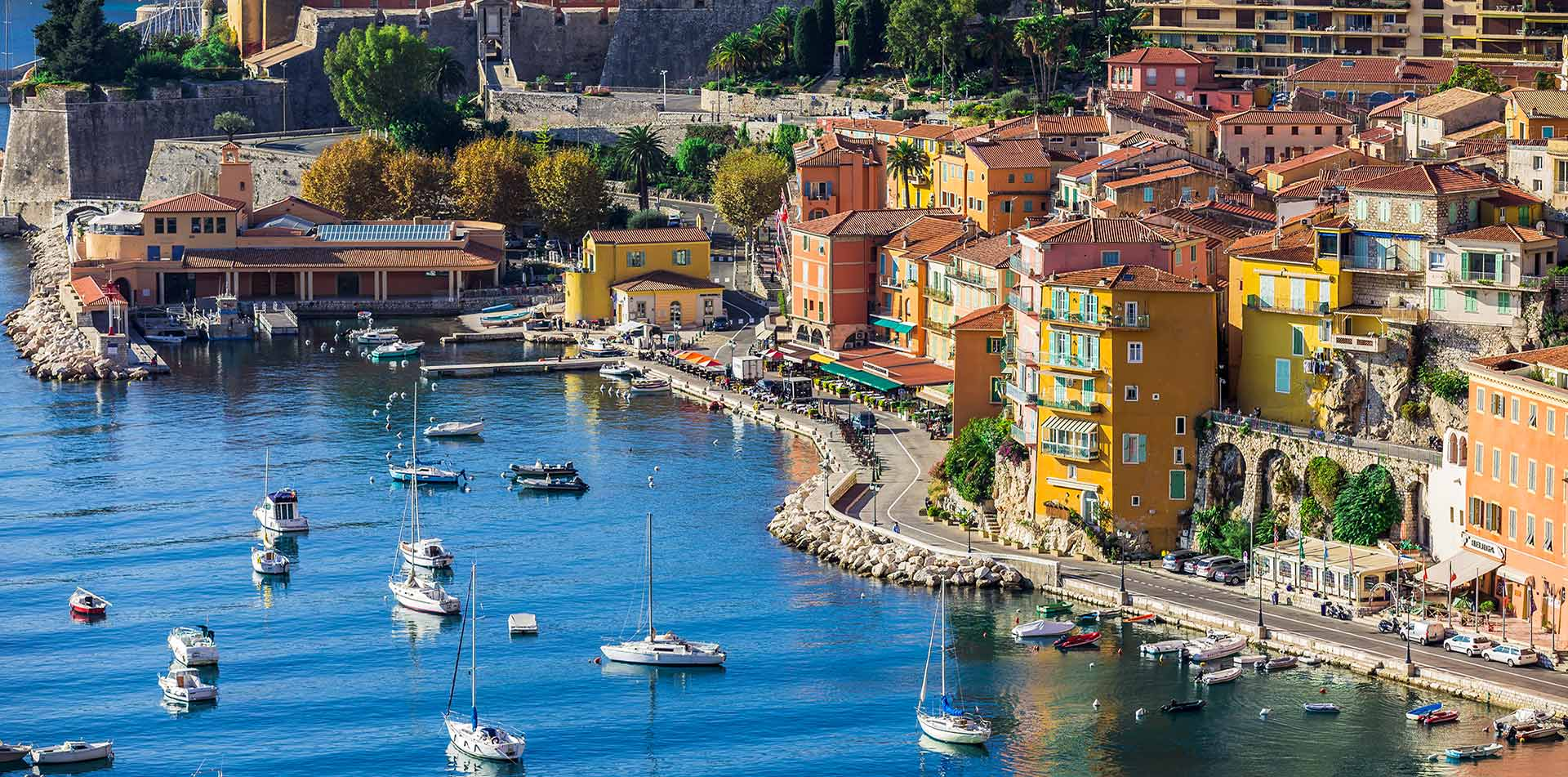 Europe France French Riveria Villafranche-sur-Mer idyllic colorful port town calm blue water - luxury vacation destinations