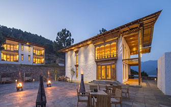 Asia Bhutan Punakha Dhensa Boutique Resort hotel exterior at night - luxury vacation destinations